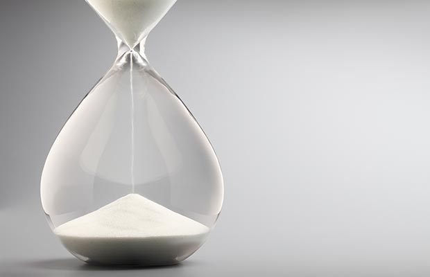 Hourglass with sand draining down